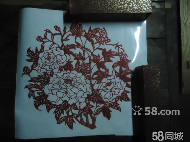 出售纯手工艺剪纸,精心刻画,刻有牡丹花,吉祥富贵之意.